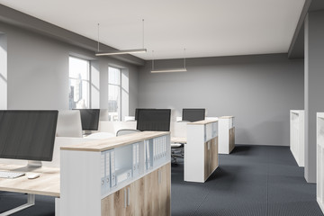 Gray and wooden open space office corner