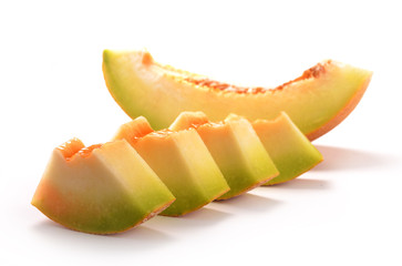Sliced yellow honeydew melon isolated on white background