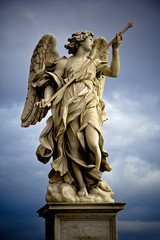Bernini's marble statue of angel with cross from the Sant'Angelo Bridge in Rome, Italy