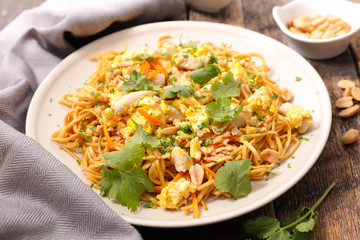 fried noodles with egg, vegetable and almond