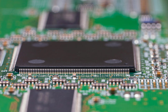 PCB with chips and SMD components. Macro photography of a fragment of a circuit Board of the electronic device