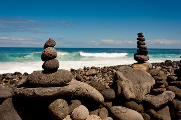 Stack of stones on the sea beach.