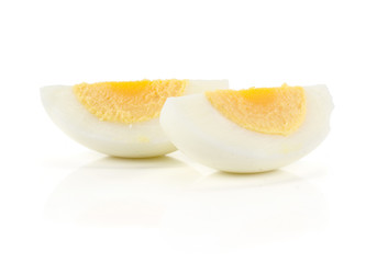 Two boiled chicken egg slices isolated on white background.