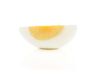 One boiled chicken egg slice isolated on white background.