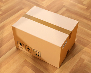 Cardboard box on wooden floor