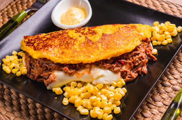 Cachapa, corn tortilla with cheese, meat and butter