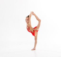 girl gymnast doing sports in rhythmic gymnastics on white background.