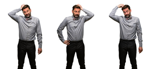 Middle age man, with beard and bow tie doubt expression, confuse and wonder concept, uncertain future