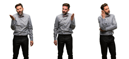 Middle age man, with beard and bow tie irritated and angry expressing negative emotion, annoyed with someone