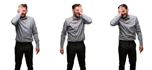 Middle age man, with beard and bow tie stressful keeping hand on head, tired and frustrated