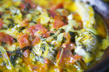 Close-up, abstract view of traditional Brazilian fish moqueca stew. Shallow depth of field.