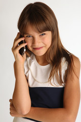 Girl in striped dress with smartphone