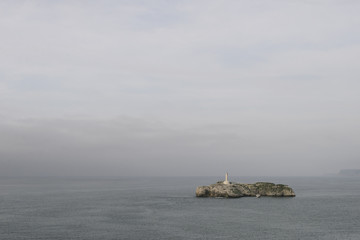 Panoramic view of Mouro Island and lighthouse in Santander, Spain