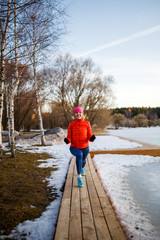 Photo of young athlete blonde at morning exercises in winter