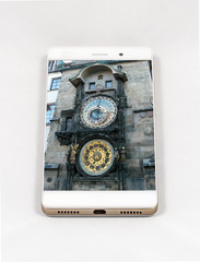 Modern smartphone displaying picture of Prague Astronomical Clock, Czech Republic