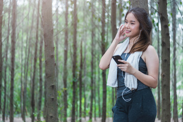 Young sport woman lifestyle using smart phone after running