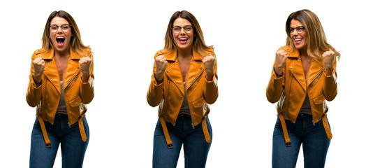 Beautiful young woman happy and excited expressing winning gesture. Successful and celebrating victory, triumphant over white background