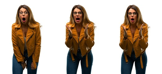 Beautiful young woman scared and surprised cheering expressing wow gesture. Unbelieving over white background