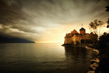 Castle at Switzerland and wonderful lake, travel destination at Lake Geneve, ancient historical landmark brick stone medival castle, backgrounds