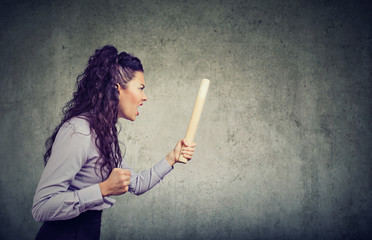 Angry woman with rolling pin screaming