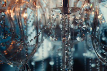 Luxury crystal chandelier close-up. Glamour background with copy space