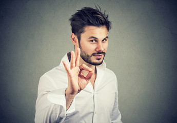 handsome confident man showing ok sign