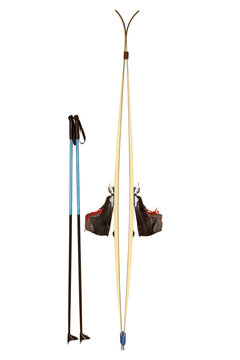 skis with sticks and boots isolated on white background