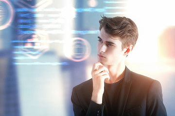 Businessman with computing code