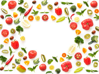 Fototapete - The concept of healthy eating. Pattern composition from vegetables and fruits, top view. Food background, vegetable frame. Tomatoes, pepper, lemon, kiwi, basil, parsley isolated on white background.