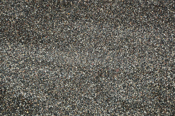 Black sand formed from the volcano and starfish for the texture,background and empty space for the text.