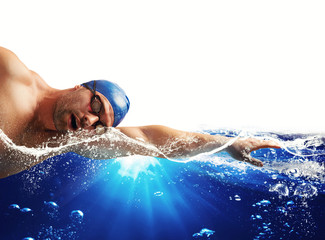 Boy swims in a blue deep water . white space for your text