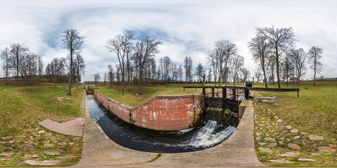 panorama 360 angle view near canal for passing vessels at different water levels.  gateway lock sluice construction on river. Full spherical 360 degrees seamless panorama in equirectangular projection