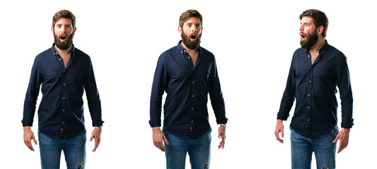 Young man with beard scared and surprised cheering expressing wow gesture. Unbelieving isolated over white background