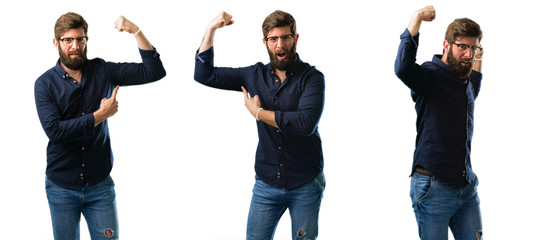Young man with beard pointing biceps expressing strength and gym concept, healthy life its good isolated over white background