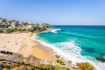 Sunny beautiful summer coast view to Sydney beach and blue Tasman Sea wild wave water and sandy white beaches perfect for surfing swimming hiking, Coogee to Bondi Walk, NSW/ Australia - 10 11 2017