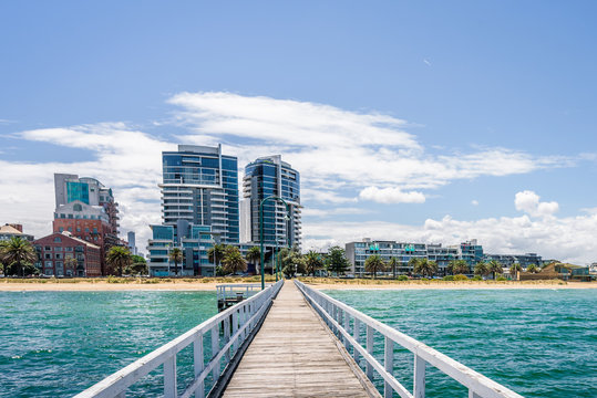 Port Melbourne, Victoria, Australia: Beautiful sunny coast view to australian blue sea and beach port harbour with cruise ship Sprit of Tasmania at shore and white gull jetty to beach bay