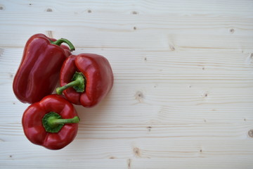 Fresh Red Biologic Peppers on Wooden Background