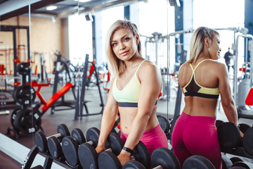 girl in the gym dumbbells