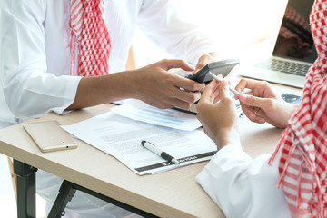 close up hand of Arabic business people working  in office