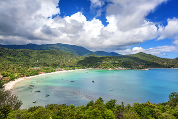 Beautiful tropical beach with blue water and green hills, top view. Koh Phangan, Thailand, Ao Thong Nai Pan Noi