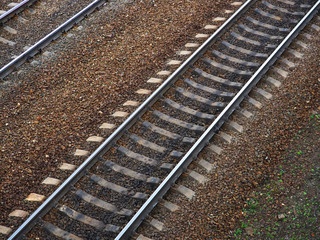 Railway. Old railroad, part of rail track for trains. Iron rails and concrete sleepers, stony ground, brown rubble