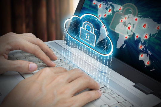 Businessman use Laptop with interface of padlock and cloud computing