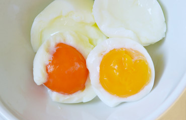boiled eggs without  shell in bowl.