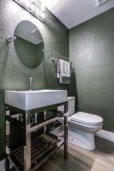 Dark Gray powder room with chrome washstand