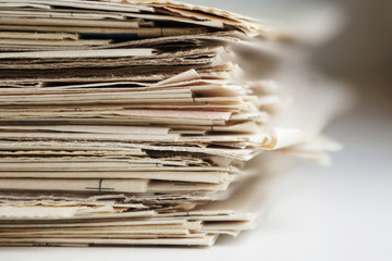 Stack of newspapers for background, close up