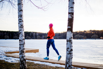 Image of young athlete blonde at morning exercises in winter
