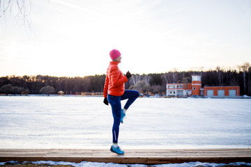 Potrtait of young athlete blonde at morning exercises in winter