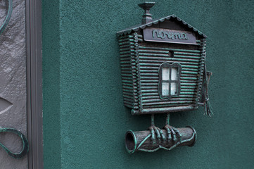 Green mailbox on the wall. inscription in Russian-mailbox
