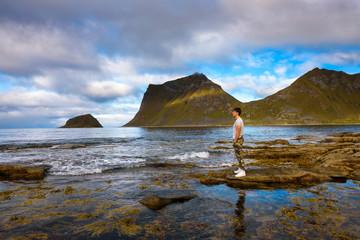 Wall Mural - Hiker at Haukland beach on Lofoten islands