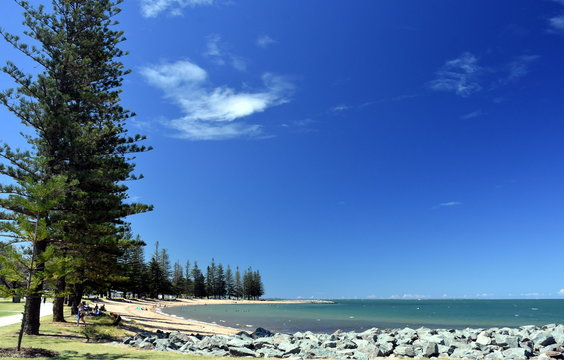 Scarborough Beach on a sunny day at Christmas time (Redcliffe, QLD, Australia). Trees around the beach.